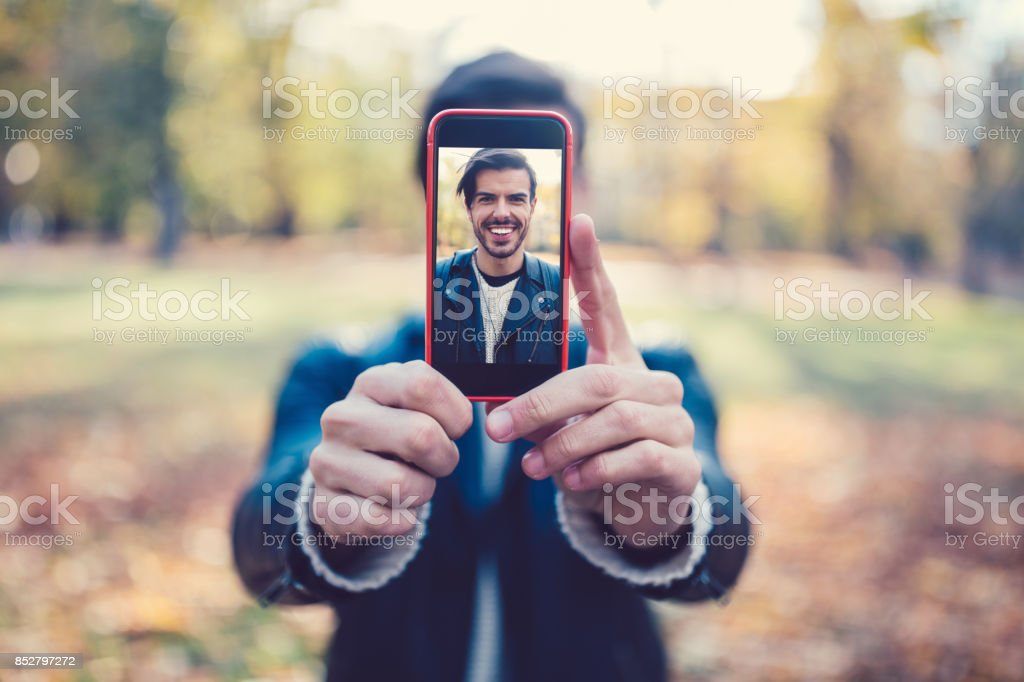 Young man showing selfie to the camera stock photo