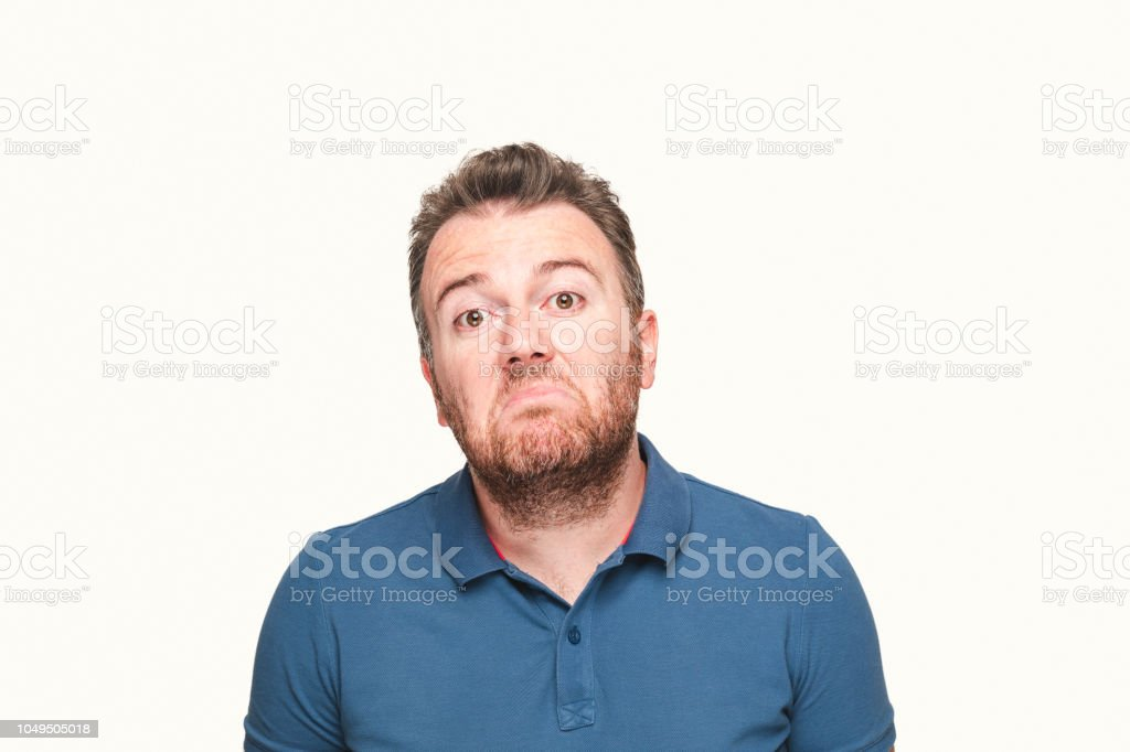 Young man showing that he doesn't know stock photo