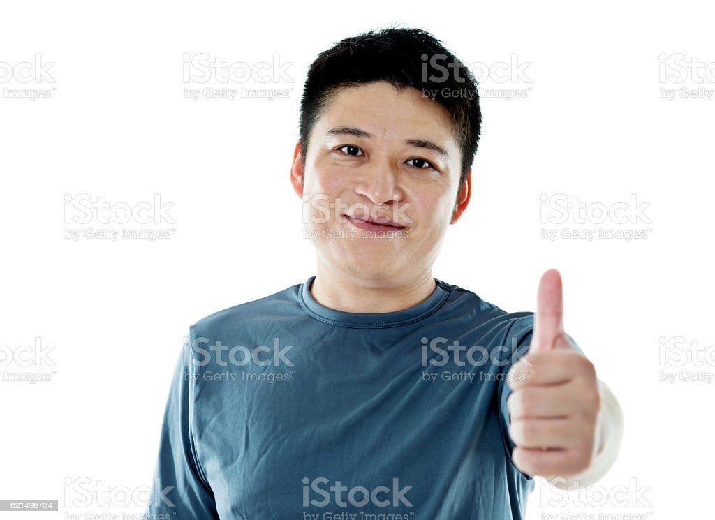 Giovane uomo mostra pollice in su segno foto stock royalty-free