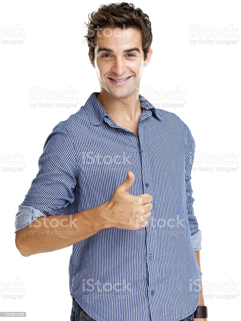 Young man showing thumbs up sign against white background royalty-free stock photo