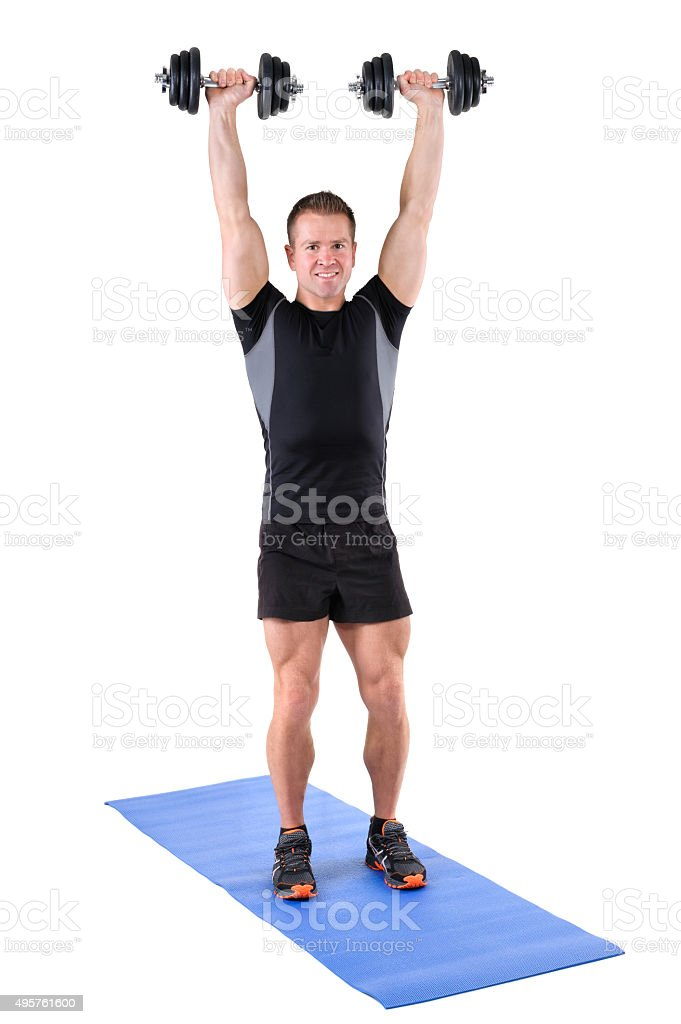 young man shows finishing position of shoulder press stock photo