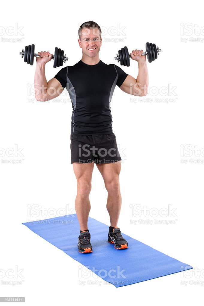 young man shows starting position of shoulder press stock photo