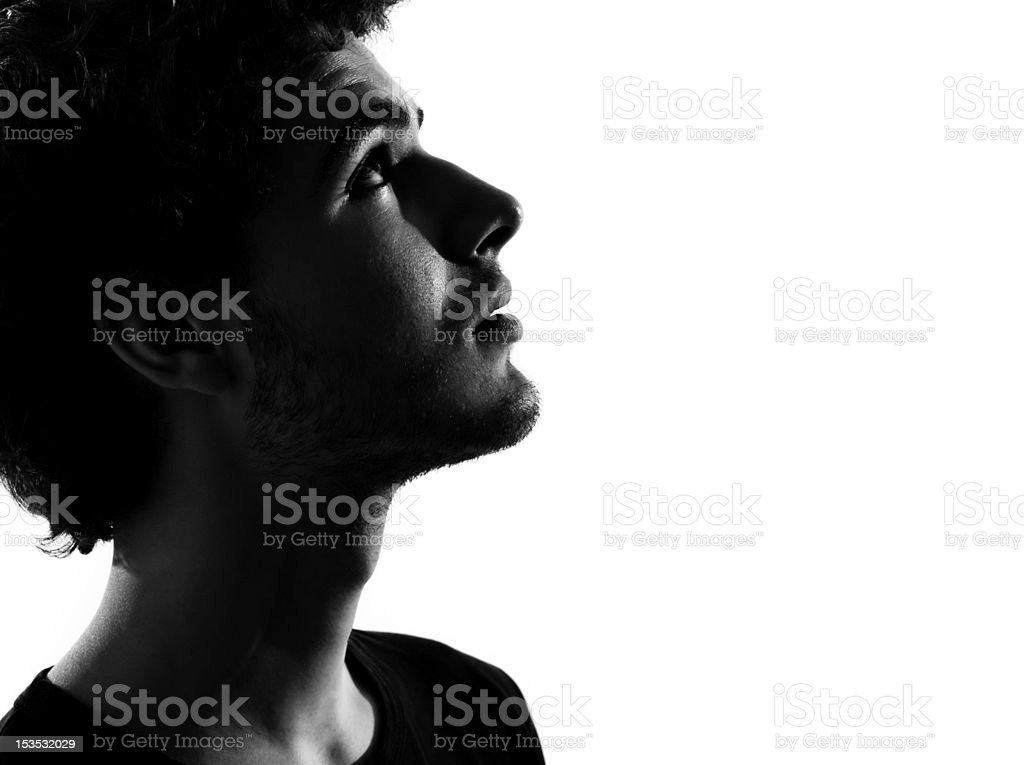 young man silhouette anxious looking up stock photo