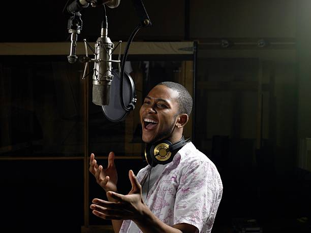 Young man singing  recording studio stock pictures, royalty-free photos & images