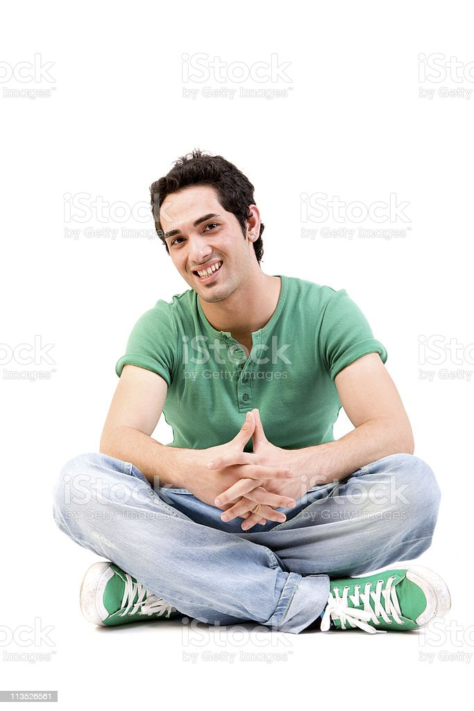 Young man sitting and smiling royalty-free stock photo