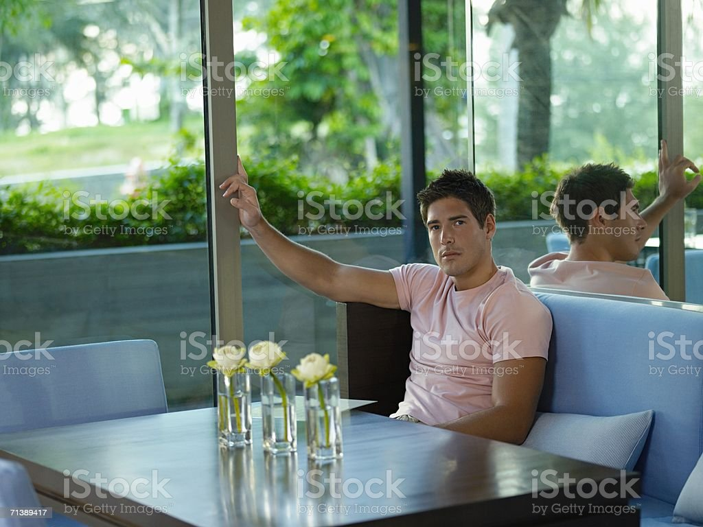 Young man sitting at table royalty-free stock photo