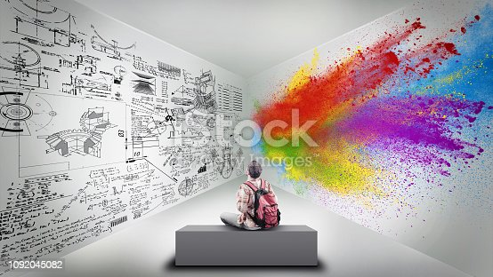istock Young man sitting in a room divided by brain hemispheres. Creative half and logical half. 1092045082