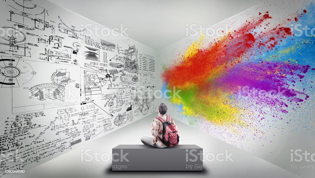 Young man sitting in a room divided by brain hemispheres. Creative half and logical half. stock photo