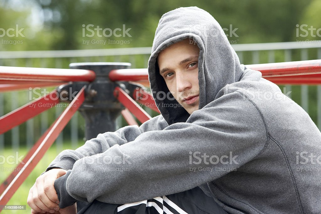 Young Man Sitting In Playground stock photo