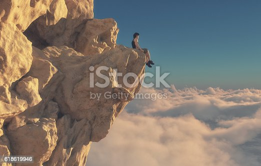 istock Young man sitting looking over mountains. 618619946