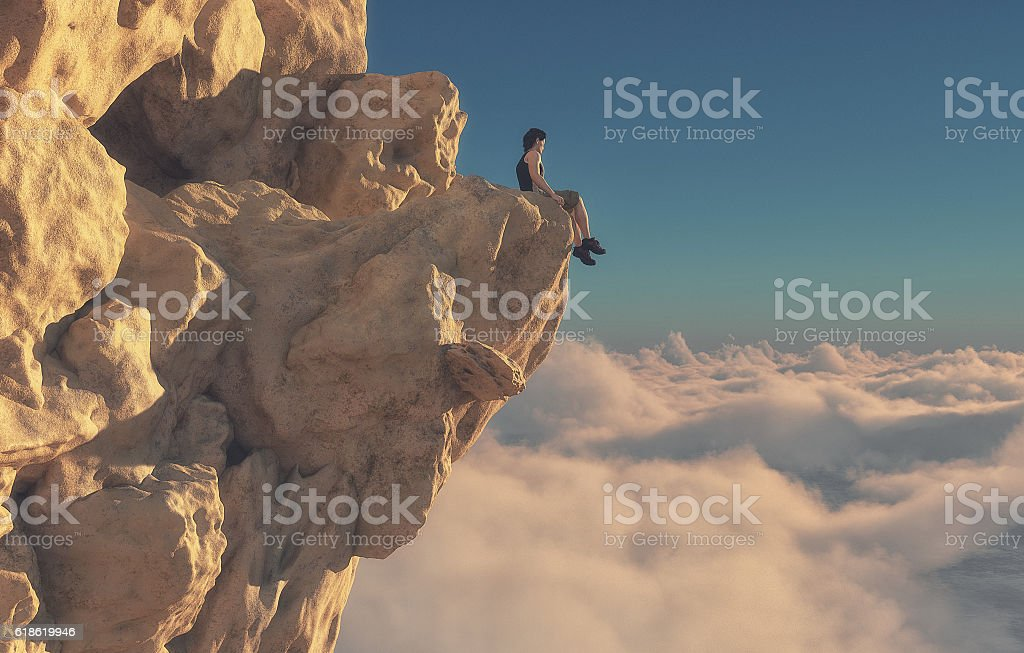Young man sitting looking over mountains. stock photo