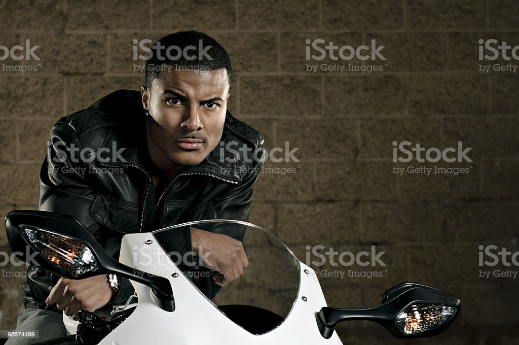 Young Man Sitting on a Sport Bike stock photo
