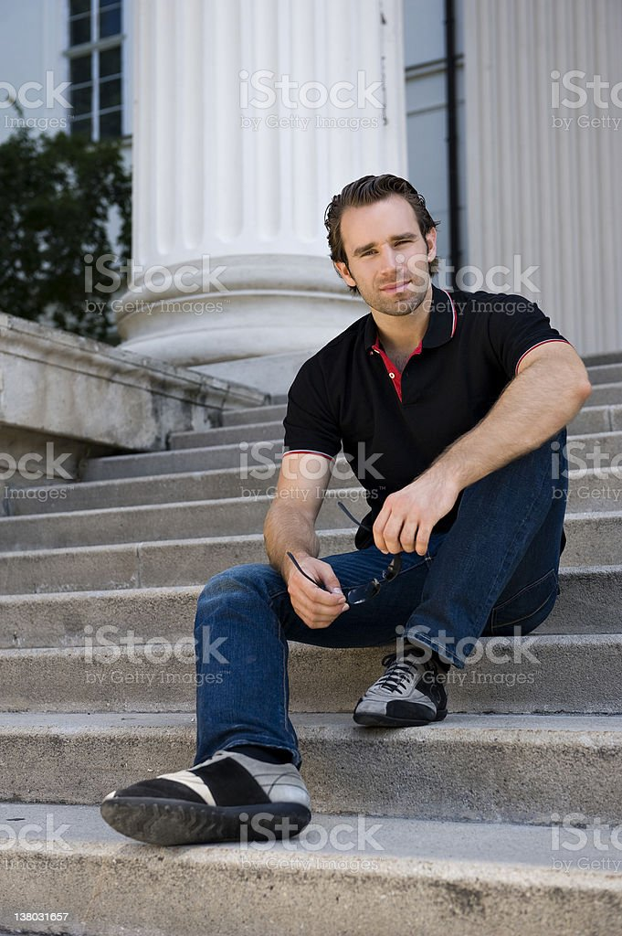 Young man sitting on stairs royalty-free stock photo