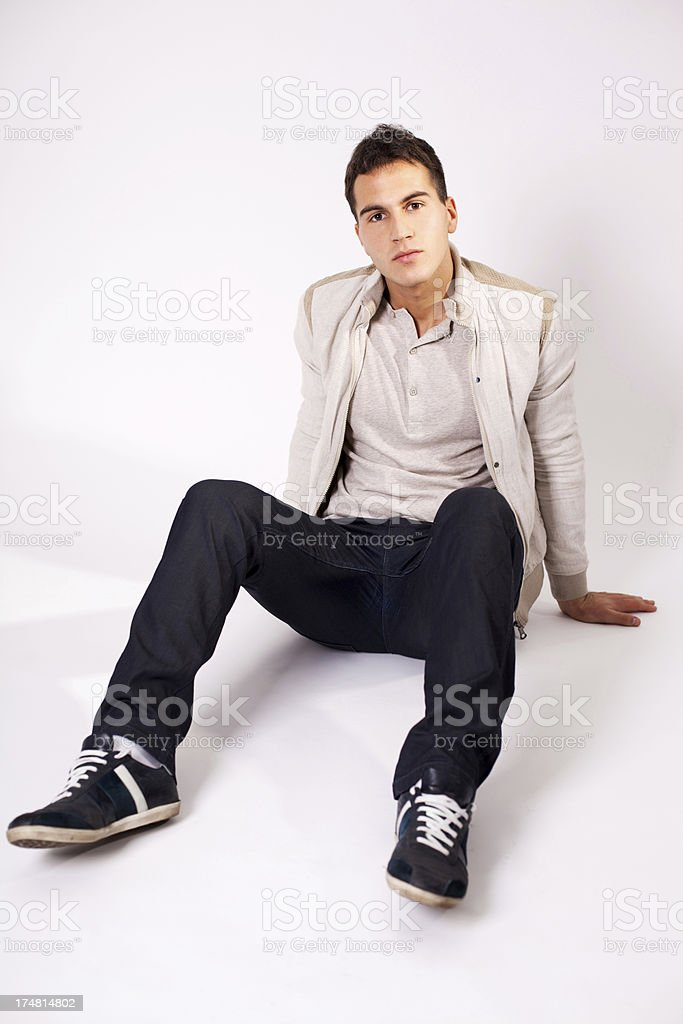 Young man sitting on the floor. royalty-free stock photo