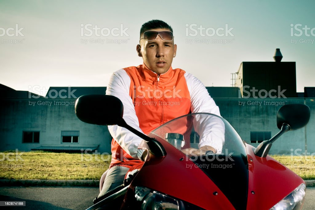 Young man sitting on the motorbike stock photo