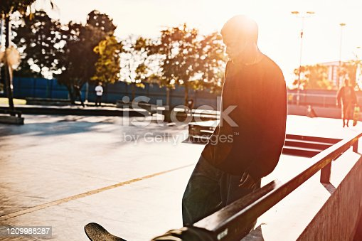 A skateboarder in LA, California rides at a skatepark, attempting an assortment of flip tricks and grinds.  Youth culture and skill in extreme sports.