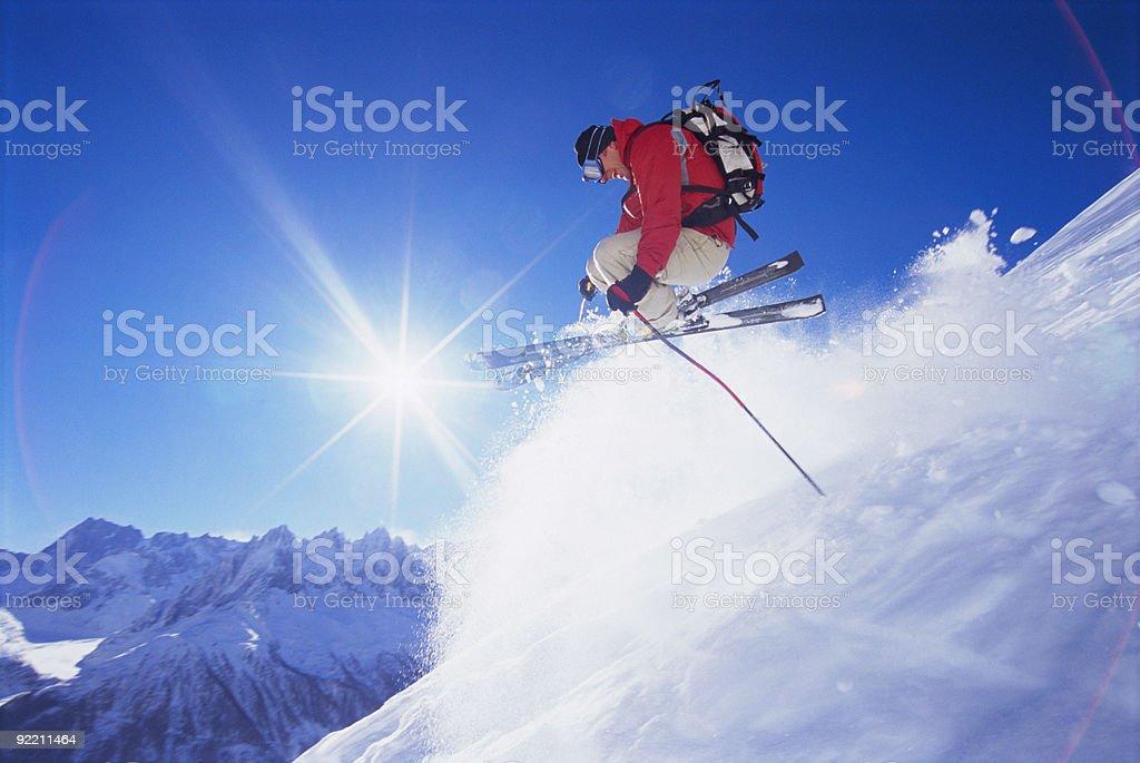 Young man skiing stock photo