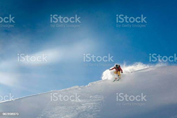 Young man skis off corniced ridge in powder snow picture id962898970?b=1&k=6&m=962898970&s=612x612&h=fs b9f34q eh5t2u1t5wne2cte2ee88zaur5xgfzose=