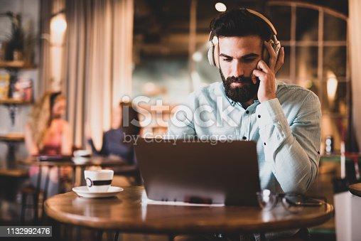 Male student studying via internet.