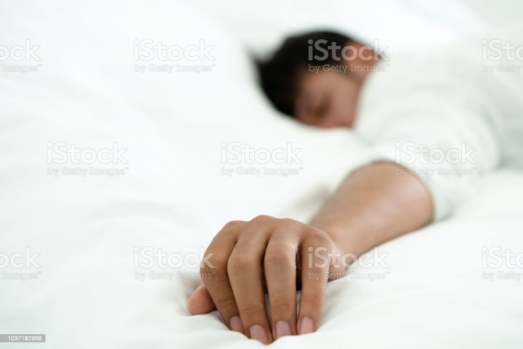Young man sleep in bed in the bedroom. stock photo