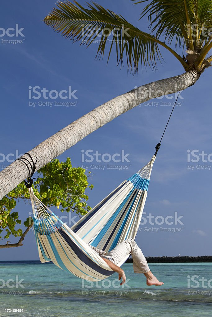 Young man sleeping in a hammock royalty-free stock photo