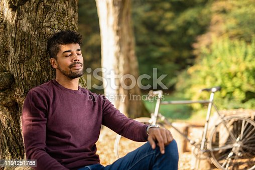 Young man sleeping in nature.