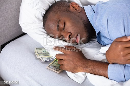 istock Young Man Sleeping On Bed In Bedroom 1062905420