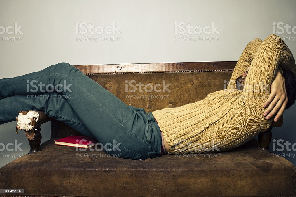 Young man sleeping on old sofa royalty-free stock photo