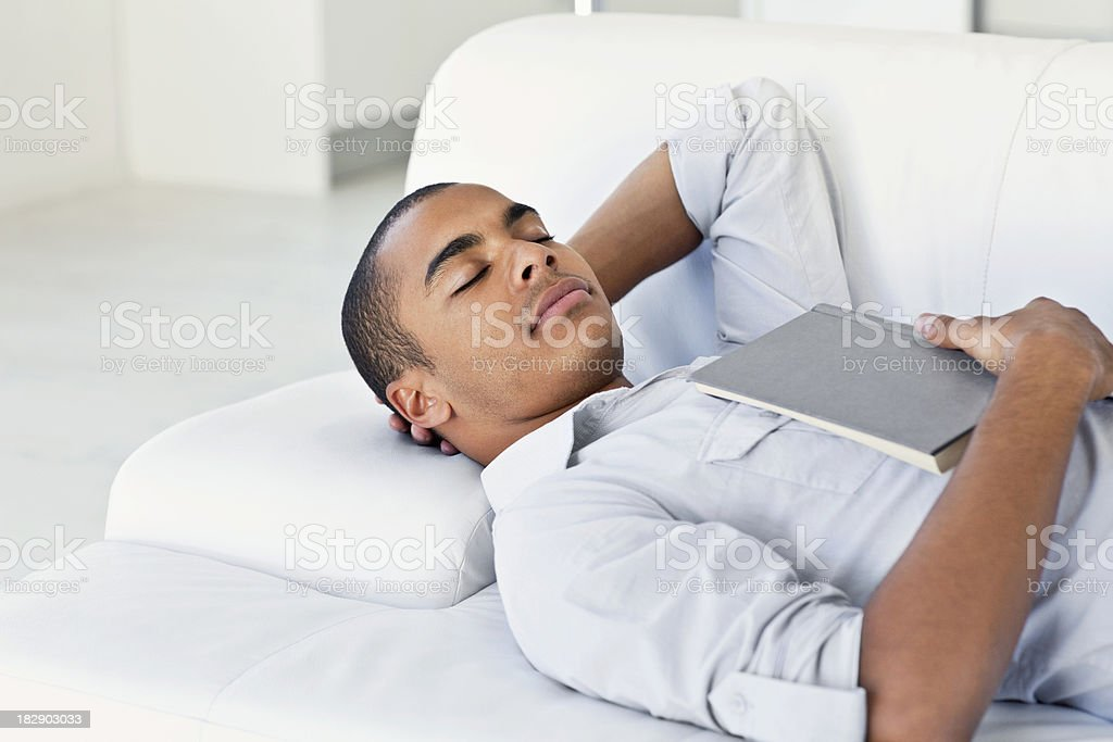 Young Man Sleeping with Book royalty-free stock photo
