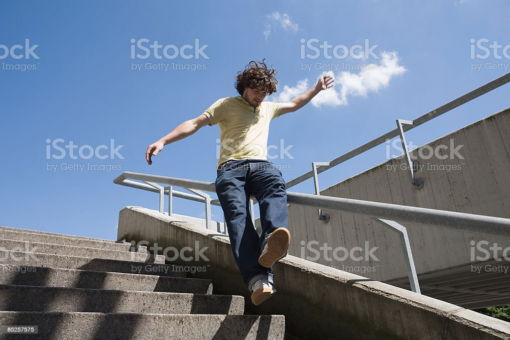Young man sliding on railings royalty-free stock photo