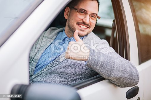1051147634 istock photo Young man smiling and showing thumbs up 1213086342
