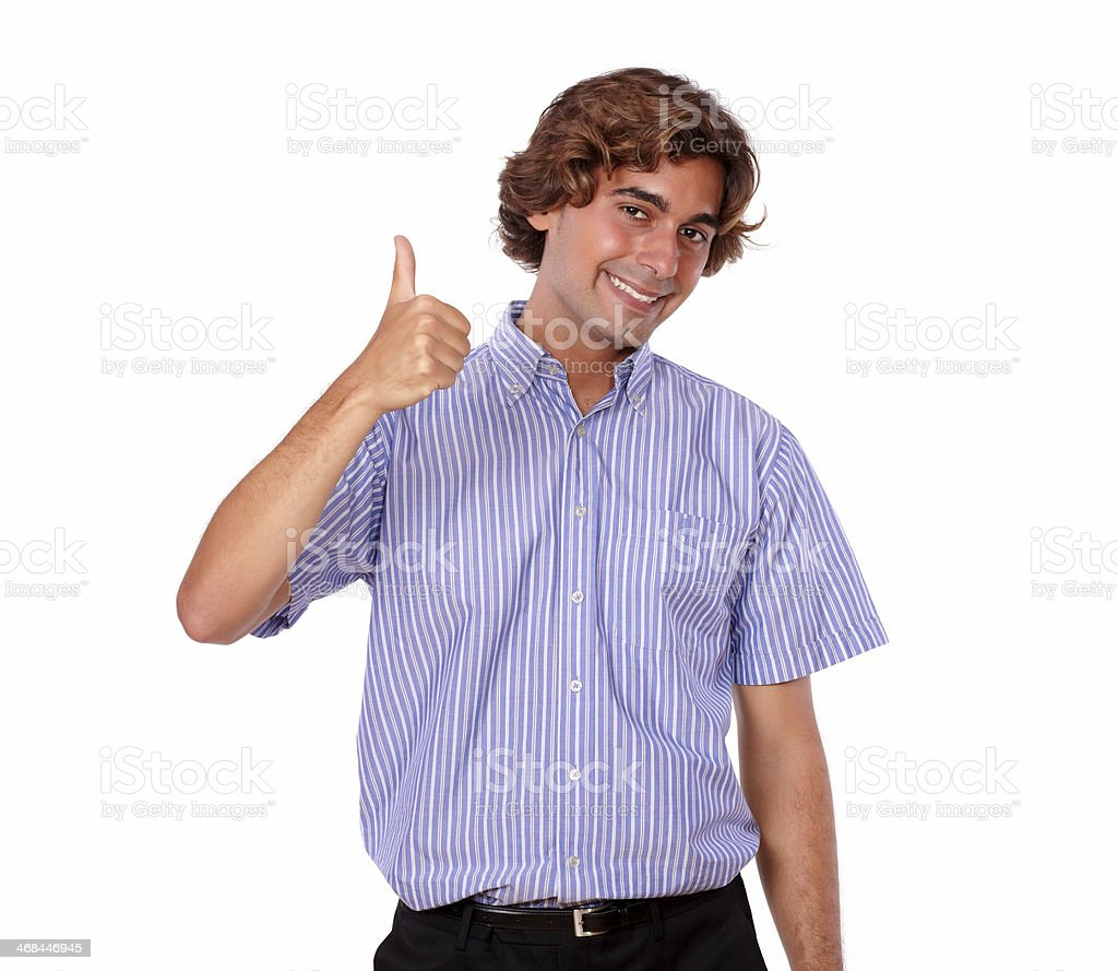 Young man smiling and showing you ok sign royalty-free stock photo