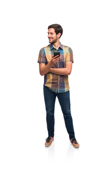 Young man smiling and social networking on his smartphone stock photo