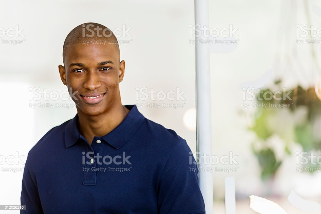 Young man smiling in cafe stock photo