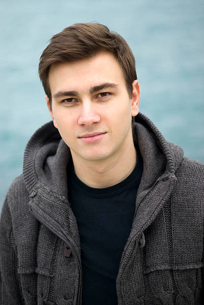 young man smiling outdoors, portrait - eastern european culture stock photos and pictures