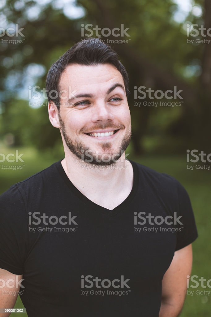 Young Man Smiling Outdoors Toned Image royalty-free stock photo