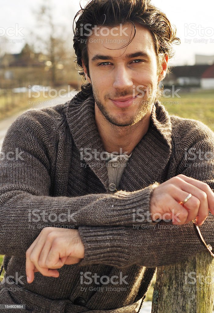 young man smiling portrait of a young man smiling and looking at camera Adult Stock Photo