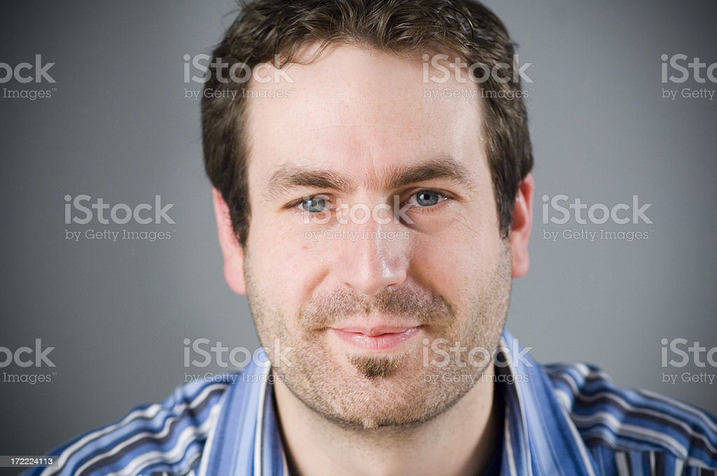 Young man smiling royalty-free stock photo