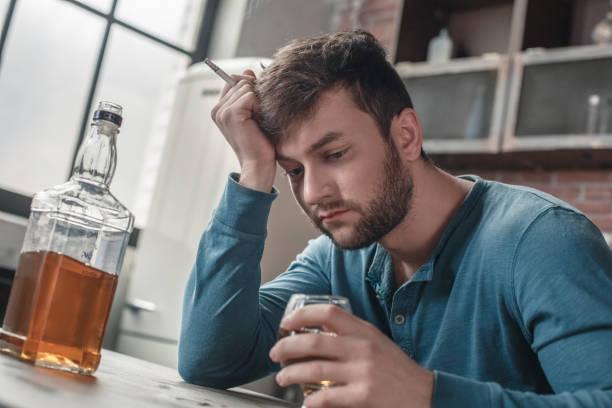 Young man smoker social problems concept looking down at whiskey picture id1143041210?b=1&k=6&m=1143041210&s=612x612&w=0&h=9c0yjdpiijhlwtok2kv3rxvnuoz0tji0abyuducz3 u=