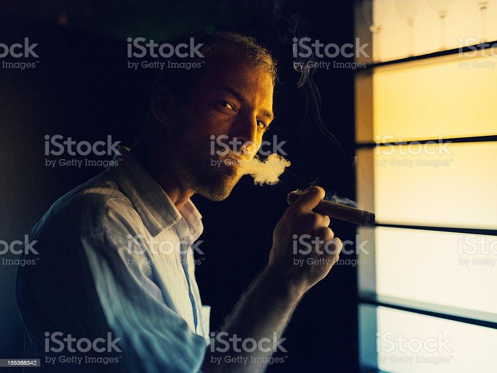 young man smoking a cigar stock photo