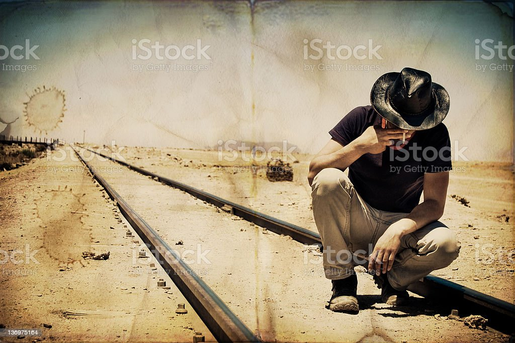 Young man smoking at railways royalty-free stock photo