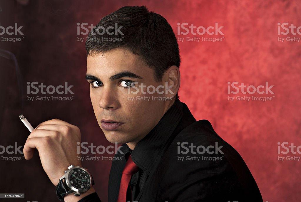 Young man smoking cigarette royalty-free stock photo