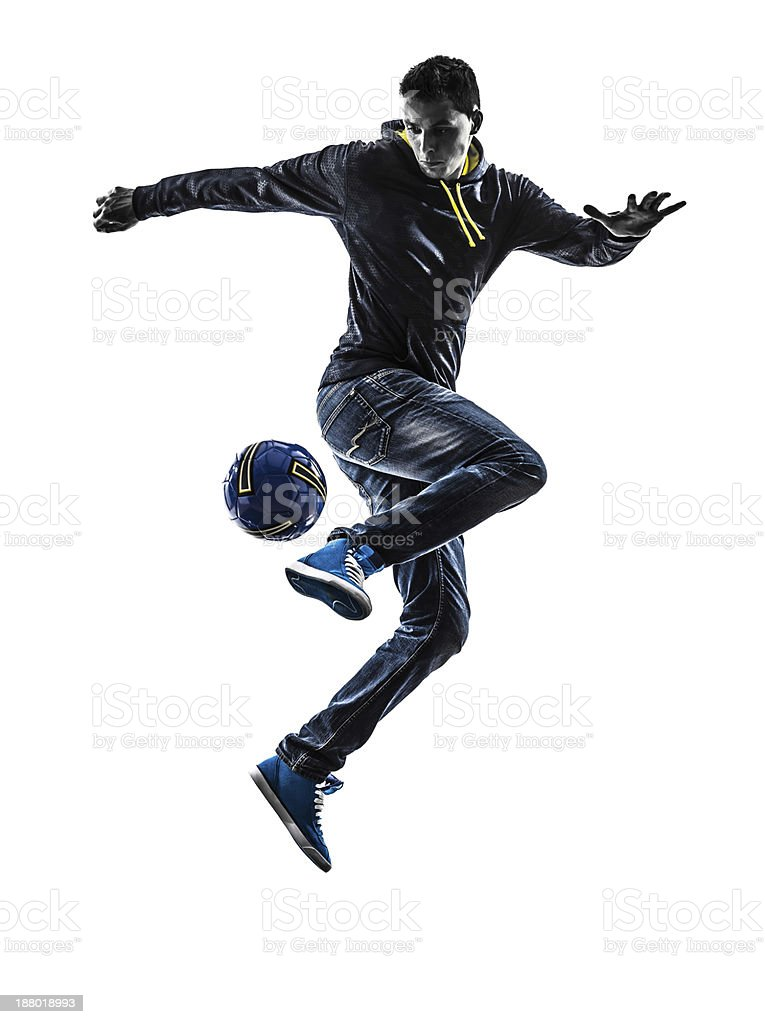 young man soccer freestyler player silhouette stock photo