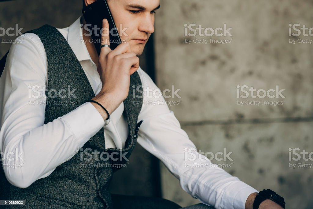 Young man speaking on his phone. stock photo
