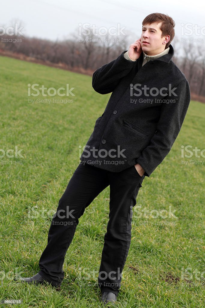 Young man speaks on his mobile phone royalty-free stock photo