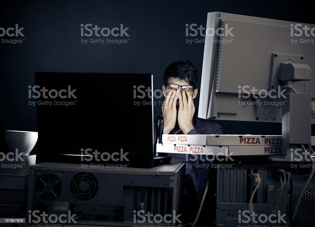 young man spending his night with computers royalty-free stock photo
