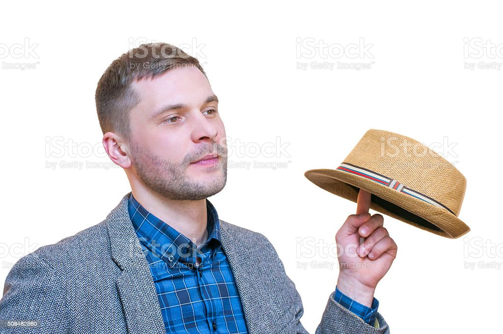 Young man spinning summer hat on his finger. stock photo