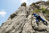 Young man sport climbing on natural rock on mountain Visocica - Bosnia and Herzegovina