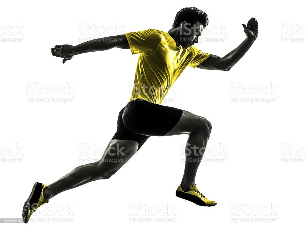 young man sprinter runner running silhouette stock photo