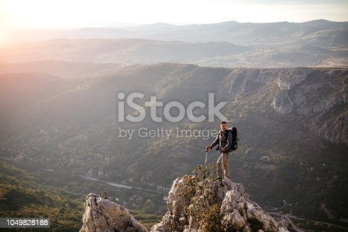 Young man Standing at Edge in Peak District
